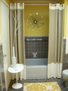 Using two shower curtains instead on one completely changes the way the bathroom looks! What an easy way to add style.