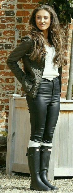 Black leather pants white socks and wellies