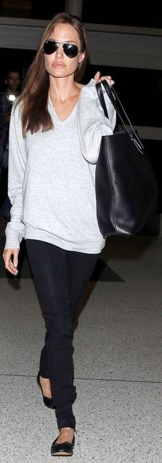 Who made  Angelina Jolie's gray v neck sweater, black tote handbag, and aviator sunglasses that she wore at LAX airport on February 14, 2014?