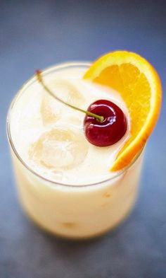 A classic Whiskey sour ~ 2 Parts Bourbon, 1 Part Lemon Juice, ½ Part Sugar Syrup, ½ Part Egg White, Cubed Ice ~ Garnish with1 cherry and an orange slice #Cocktail #Drink #EuropeanBartenderSchool