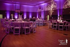 Idea for transforming the gym: purple colored wall lights (to match your theme) is an idea. I know they rent these for weddings.
