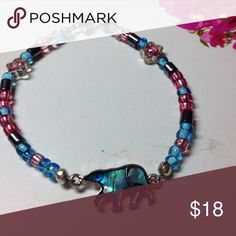 💞 GIRLS BRACELET # GB 1 POLAR BEAR This bracelet is made with 49 strand wire Two silver hollow stars , hematite, multi colored spacer beads such as aquarium blue and hot pink. The centerpiece Is a polar bear with Abalone encased in epoxy. Silver plated magnetic clasp. Fireglow Gem Accessories Jewelry