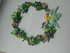 Fairy/faerie/fairies wreath, wildflowers and a beautiful fairy made from polymer clay (fimo) and then dusted with mica powders.    www.facebook.com/fimotastique