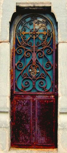 Rusted and beautiful iron cross door.