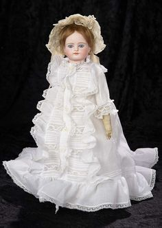 """Interlude"" - Marquis Catalogued Auction - March 11, 2017: 228 Beautiful Sonneberg Bisque Doll with Closed Mouth and Superb Gown"