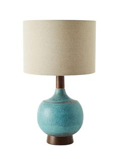 "A special glaze gives the ceramic base that speckled look. Modernist 23""-tall lamp with linen shade, $149, westelm.com"