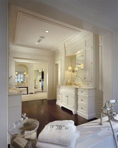Traditional Master Bathroom with Williams sonoma monogram bath towel, Drop-In Bathtub, Art desk, Simple Marble, Flush
