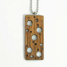 Laser cut jewelry. Wooden pendant.