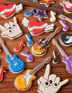 Rock and Roll Cookies -- whole site has great ideas about cookie decorating… Music Cookies, Star Cookies, Roll Cookies, Fancy Cookies, Iced Cookies, Cute Cookies, Royal Icing Cookies, Cookie Icing, Party Rock