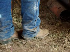 A real cowboy has dirty boots most of the time.
