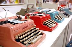 """Some Royal typwriters on display in the UPPERCASE studio for a typewriter event a few years ago. Each tag included a little history or story about the machine.  """"All my typewriters are working,"""" Janine notes, """"each with its own endearing faults and sticky keys."""""""