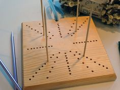 Handmade solid pine blocking board for needle crafts. Includes 12 bamboo pins and instruction sheet showing possible combinations.  Each board