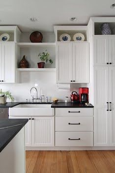 Love this kitchen. I especially like how they built up the area above the existing cabinets.