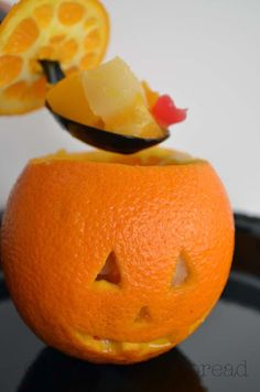 Fruit Snack O'Lantern for Halloween! I can't wait to make this with my kids for a yummy, healthy snack.