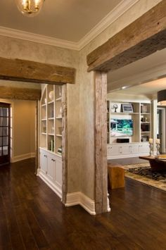 Love the rustic barn framing with the formal baseboard & crown