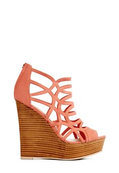 If you want to add subtle color to your outfit, try a light coral wedge with gorgeous details!