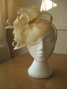 Champagne Gold Fascinator and Feather Fascinator on a hairband, races, weddings, special occasions. £30.00, via Etsy.
