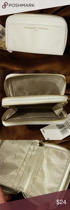 NWT Adrienne Vittadini Wallet Brand New Beautiful White 2 Pocket Wallet. Front pocket with 6 card slots, a cash fold and a generous pouch.  Both sides secure with a gold zipper. One pull is missing and has been replaced by me with a lovely rhinestone accent pull. Adrienne Vittadini Bags Wallets