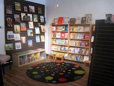 If you want your display on slatwall to stand out, paint it an accent color. Childrens Bookstore, Modern Books, Book Cafe, Book Displays, Slat Wall, Accent Colors, Spectrum, New Books, The Dreamers
