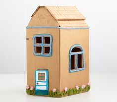 Cardboard Box Houses @ Honest to Nod  Nice little project to have on hand for the 2 weeks of Springbreak that starts next week!!  Yes, 2 whole weeks!  Not a typo!!