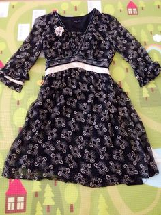 FAKE Anna Sui dress using copy of real print. Anna Sui copyrights all of her fabric prints.
