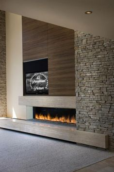 I like the stone wall. It helps elevate the space and draw the eye upward making the room appear bigger. Family Room Fireplace, Fireplace Wall, Fireplace Mantels, Concrete Fireplace, Modern Fireplace, Living Room Modern, Living Room Designs, Denmark House, Contemporary Fireplace Designs