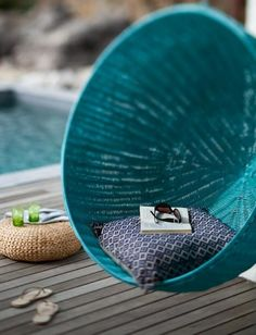 Turquoise pool chair - @sarah Duffus would look good sitting there, you guys should get one for summer!