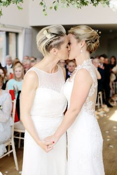 same sex wedding brides first kiss photo