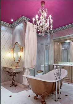 I love everything about this - especially the ceiling color and the gold paint on the tub.