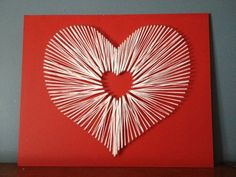 More artistic heart shaped symbols using paper. The white piece of paper has been folded and put together to look like it's endlessly creating a loop of heart.