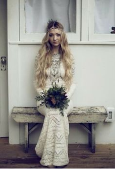 Boho wedding dress. That necklace too.