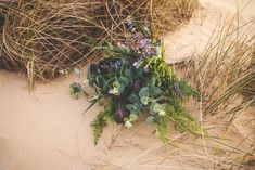 A wedding shoot beside the seaside in Suffolk | Whimsical greenery bridal bouquet | bridemagazine.co.uk