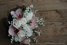 The bridal bouquet full view. Vendella roses, peach phaleanopsis, lily of the valley in willow ring.