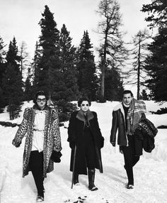 Egyptian Princess Nasli Shah (left), wife of Prince Abdel Moneim, goes for a stroll through the snow with young Peter Zervudachi and Princes...