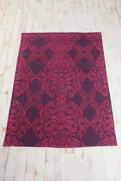 The UO version, of the deep pink rug - i saw this first, then the other interior shot put it all into place - in my price range!