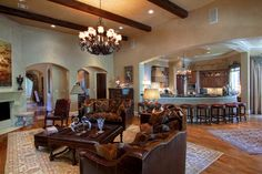 High ceilings with hardwood beams make a cozy living room (27x22). Fireplace is wood burning or gas log with cast iron mantle and surround.