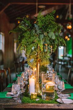 Fern centerpiece, greenery arrangement, antique candelabra, floating candles, moss table runner //  Riverland Studios