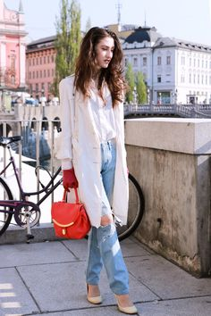 Fashion blogger Veronika Lipar of Brunette From Wall Street sharing how to style ripped jeans this spring