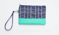 A beautiful color combination and fabulous, fun, herringbone print.    Designer cotton fabric in a navy blue herringbone / chevron print accented