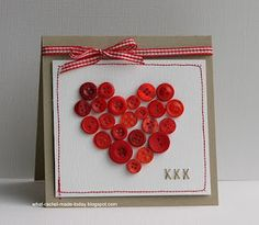 button heart and stitched Xs