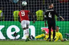 Manchester United's Belgian striker Romelu Lukaku shoots and scores during the UEFA Super Cup football match between Real Madrid and Manchester...