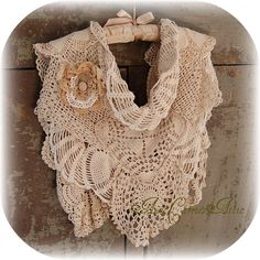 Crochet lace scarf can be worn several ways. Just goes to show what I could do with some of the doilies I have stashed in the linen closet.