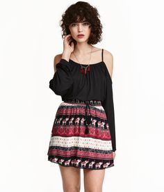Check this out! H&M LOVES COACHELLA. Short top in soft jersey with a sheen. Narrow shoulder straps, open shoulders, and trumpet sleeves. - Visit hm.com to see more.