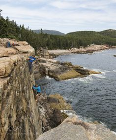 Climber on the Otter Cliffs by BenjaminMitchell