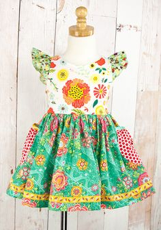 EMERALD CITY SARA TOP $36.00 | Code: P15FT16 3 Description Born with love in the USA **Skirt trim may vary** 6951