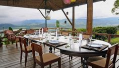 Family style dining table at Hacienda Tayutic in Costa Rica. House only has 6 rooms available.