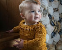 To make: The sweater, not the baby (yet).  I WILL make this sweater if it takes me 'till I'm 80 (which it probably will).  SO CUTE, I'm obsessed.