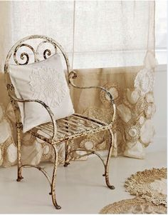 Rusty chair, lace doily curtains