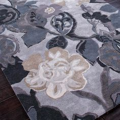 Hand-tufted wool-blend rug with floral motif.   Product: RugConstruction Material: Wool and art silkColor:...