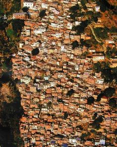 Favelas in Rio, informal housing with often times no electricity or water. How can we address the issue of rising populations in cities and be able to provide basic utilities to everyone?